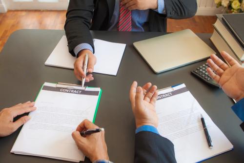 Businessmen enter into joint venture agreements